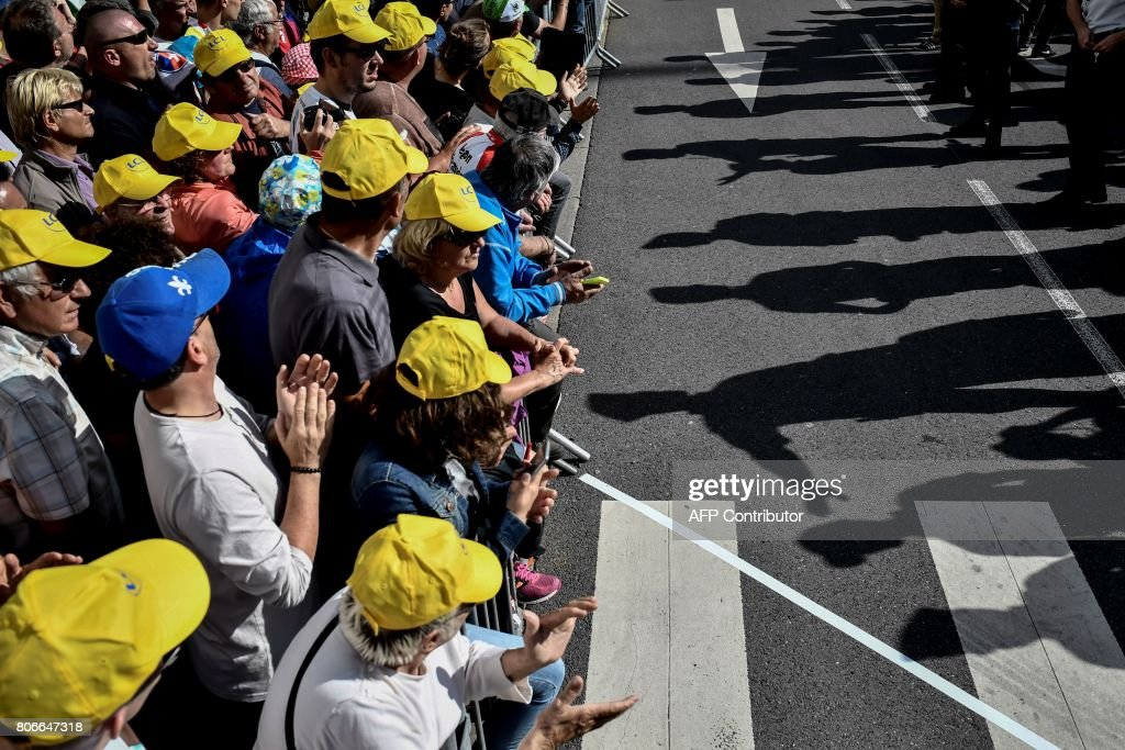Supporters wait for riders near the finish line during the 212,5 km third stage of the 104th edition of the Tour de France cycling race on July 3, 2017 between Verviers, Belgium and Longwy, France. / AFP PHOTO / Jeff PACHOUD