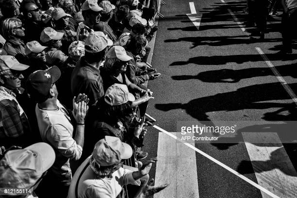 Supporters wait for riders near the finish line during the 2125 km third stage of the 104th edition of the Tour de France cycling race on July 3 2017...