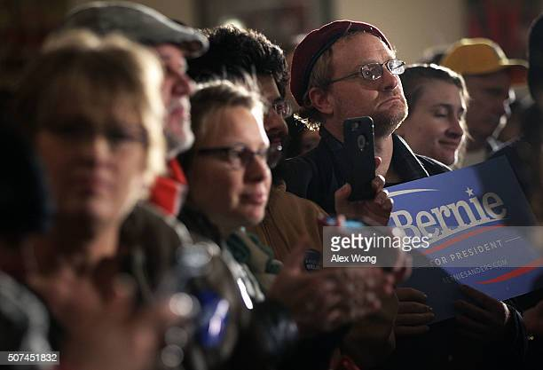 Supporters wait for the arrival of Democratic presidential candidate Sen Bernie Sanders at a campaign rally at Danceland Ballroom January 29 2016 in...
