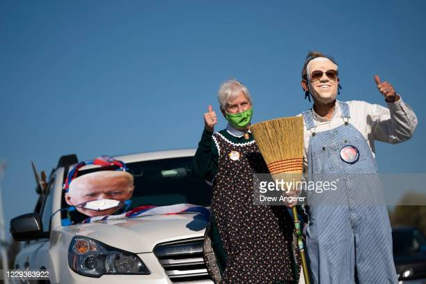 Supporters wait for the arrival of Democratic presidential nominee Joe Biden during a drive-in campaign rally at the Iowa State Fairgrounds on...