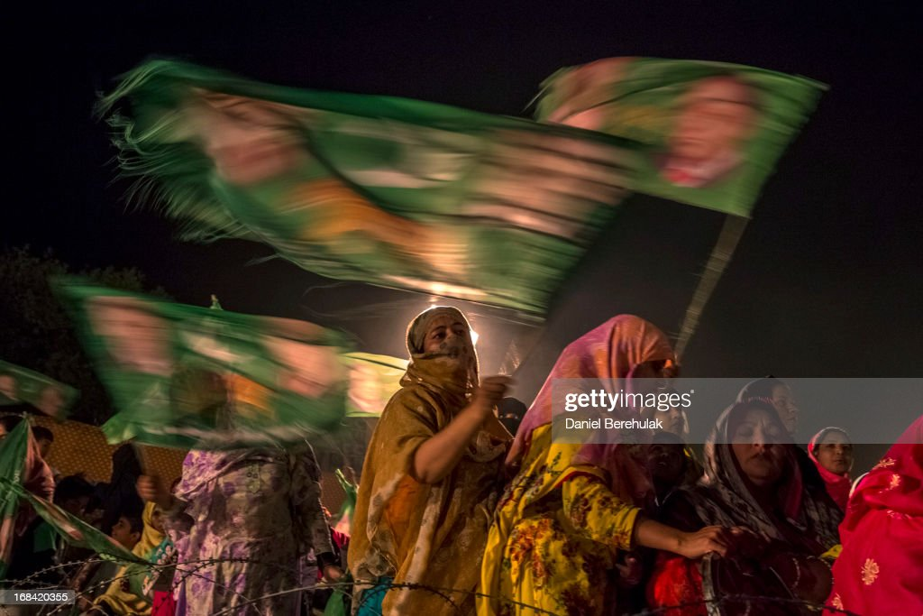 Supporters wait for the arrival of Nawaz Sharif, leader of the Pakistan Muslim League-N (PML) party, during the final day of campaigning at an election rally on May 09, 2013 in Lahore, Pakistan. Imran Khan, chairman of Pakistan Tehrik e Insaf (PTI) was injured at a rally in Lahore on Tuesday after having fallen 15 feet whilst being lifted onto a stage with only 2 days of campaigning to go. Nawaz Sharif of the Pakistan Muslim League-N (PMLN) cancelled one day of campaigning in respect to his injured opponent yesterday. In the last day of campaigning Imran Khan addressed a rally via telecast from his bedside in hospital. Nawaz held his final rally in his stronghold city of Lahore. Pakistan's parliamentary elections are due to be held on May 11. It is the first time in the country's history that an elected government will hand over power to another elected government.