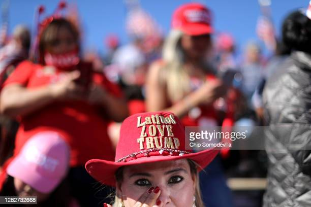 Supporters wait for the arrival of U.S. President Donald Trump during a campaign rally at Phoenix Goodyear Airport October 28, 2020 in Goodyear,...
