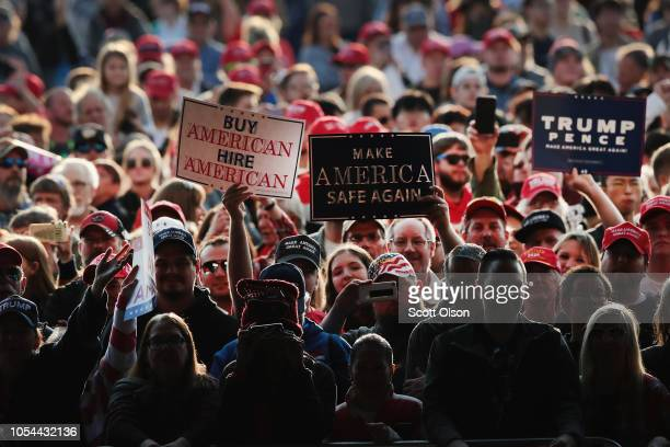 Supporters wait for the arrival President Donald Trump at a rally at the Southern Illinois Airport on October 27, in Murphysboro, Illinois. Trump was...