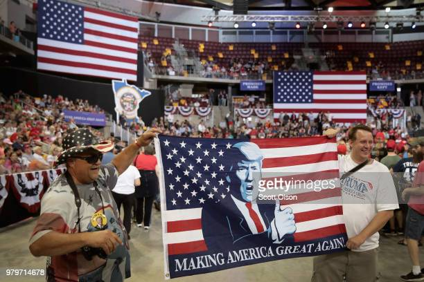 Supporters wait for the start of a campaign rally with President Donald Trump at the Amsoil Arena on June 20 2018 in Duluth Minnesota Earlier today...