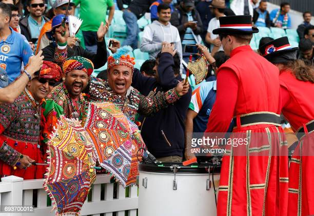 Supporters wait for the start of the ICC Champions Trophy match between India and Sri Lanka at The Oval in London on June 8 2017 / AFP PHOTO / Ian...