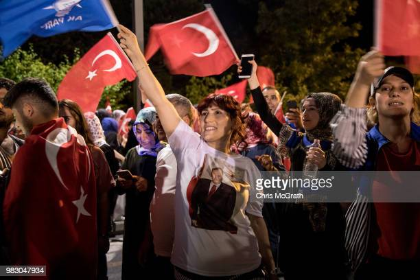 Supporters wait for Turkey's President Recep Tayyip Erdogan to speak outside the entrance of Huber Presidential Palace on June 24 2018 in Istanbul...