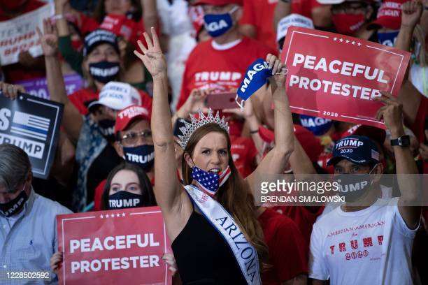 Supporters wait for US President Donald Trump during an indoor campaign rally at Xtreme Manufacturing in Henderson, a suburb of Las Vegas, Nevada, on...