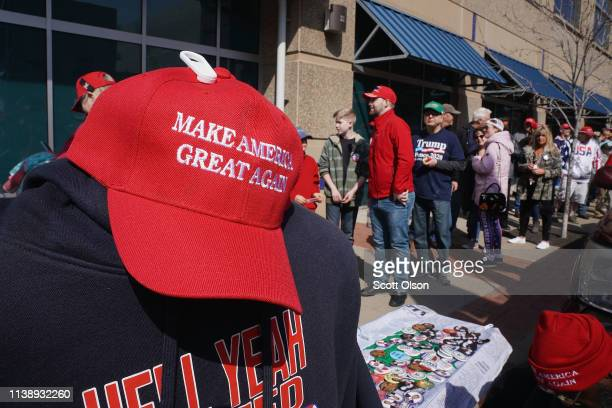 Supporters wait in line before the start of a rally with President Donald Trump at the Van Andel Arena on March 28 2019 in Grand Rapids Michigan...