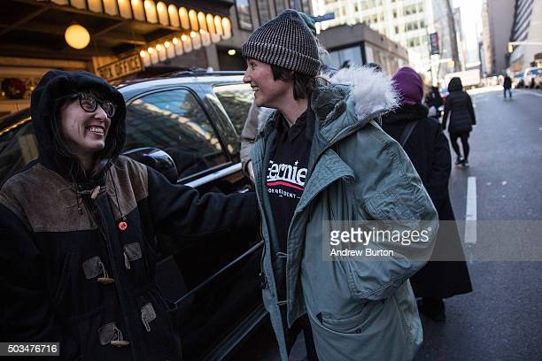 Supporters wait in line outside to listen to Democratic presidential candidate Sen Bernie Sanders outline his plan to reform the US financial sector...