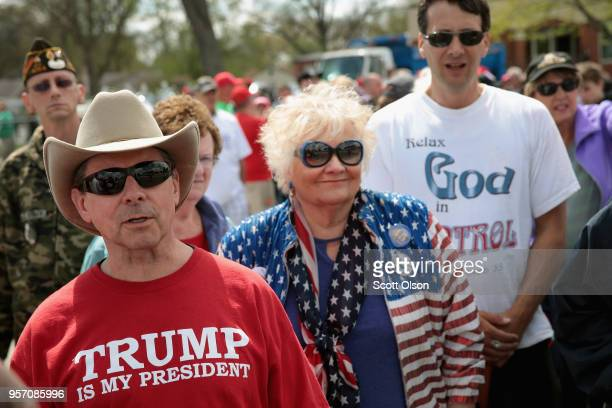 Supporters wait in line to attend a campaign rally with President Donald Trump on May 10 2018 in Elkhart Indiana The line to enter the event which...
