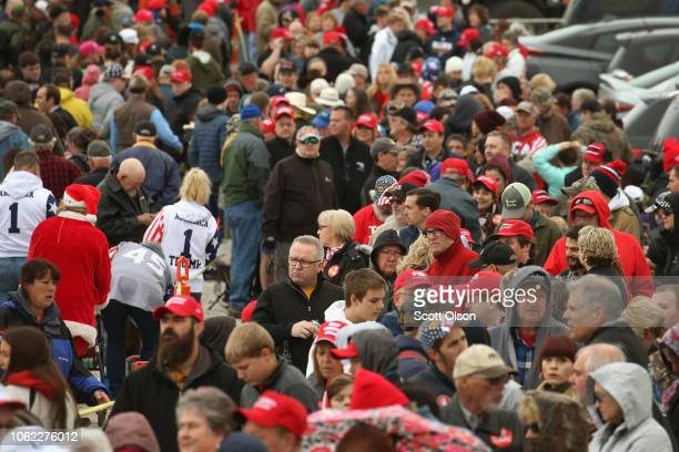 Supporters wait in line to see President Donald Trump at a rally in support of U S Senate candidate Josh Hawley on November 1 2018 in Columbia...
