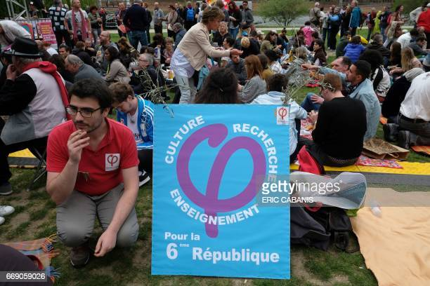 Supporters wait prior to a rally of the French presidential election candidate for the farleft coalition 'La France insoumise' at the Prairie de...