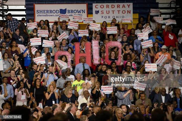 Supporters waive signs during a campaign rally for Ohio Gubernatorial candidate Richard Cordray at CMSD East Professional Center Gymnasium on...