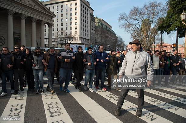 Supporters walk in front of a van carrying Hebe de Bonafini leader of the Mothers of Plaza de Mayo human rights organization as she leaves Plaza de...