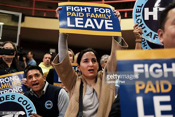 Supporters watch as New York Governor Andrew Cuomo speaks to promote his paid family leave initiative at a rally in Manhattan Thursday morning on...