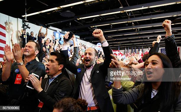 Supporters watch as results are announced during the caucus night event of Democratic presidential candidate former Secretary of State Hillary...
