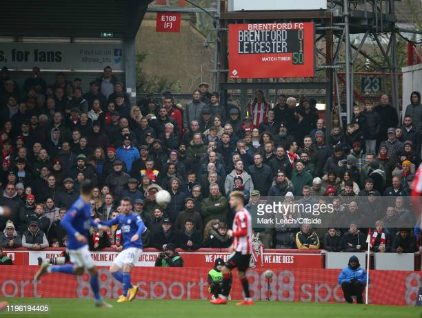 supporters watch from the Ealing Road terrace during the FA Cup Fourth Round match between Brentford FC and Leicester City at Griffin Park on January...