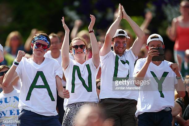 Supporters watch on from Murray Mound as Andy Murray of Great Britain and Milos Raonic of Canada are in action during the Men's Singles Final on day...