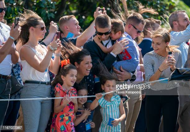 Supporters watch President Donald Trump take off in Marine One on the South Lawn of the White House on August 09 2019 in Washington DC Donald Trump...