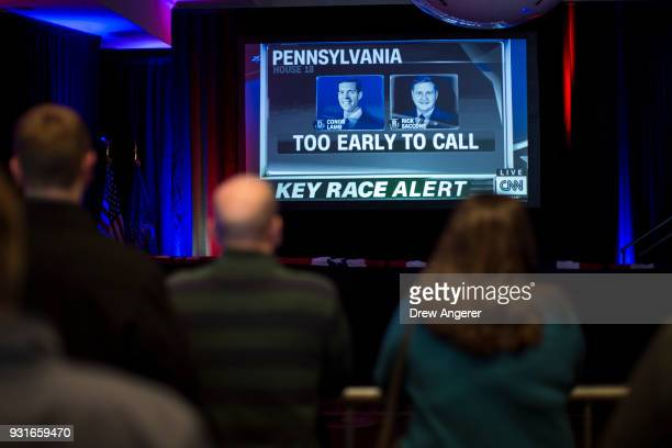 Supporters watch returns at an election night event for Conor Lamb Democratic congressional candidate for Pennsylvania's 18th district March 13 2018...