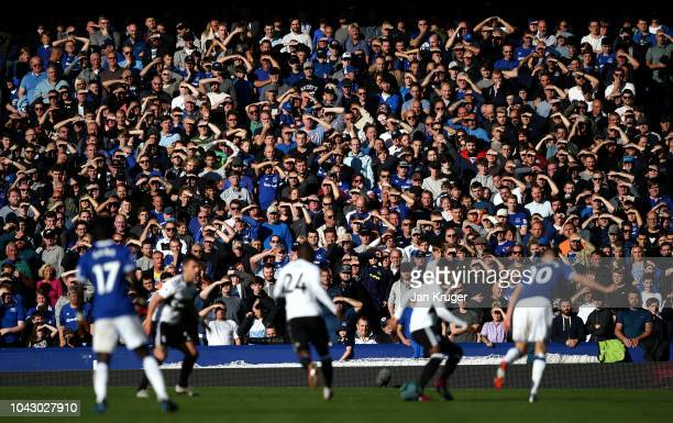 Supporters watch the action during the Premier League match between Everton FC and Fulham FC at Goodison Park on September 29 2018 in Liverpool...