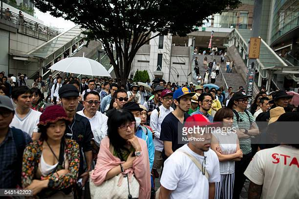 Supporters watch the campaign speech of candidate Yohei Miyake for 2016 July's House of Councillors elections outside Shinjuku Station on July 5...