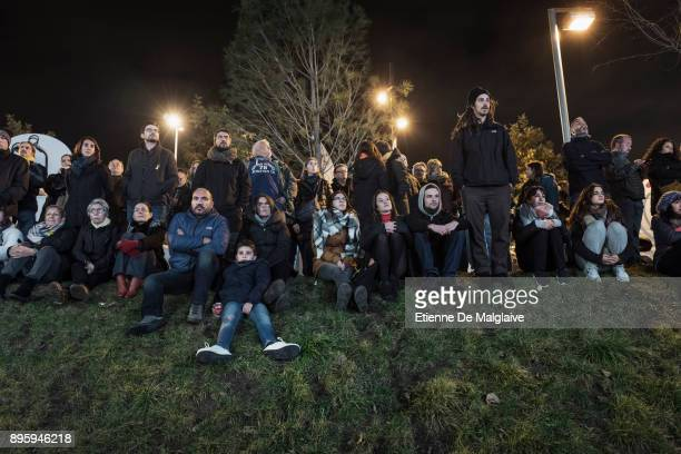 Supporters watch the last campaign meeting of independentist party Esquerra Republicana in the outskirts of Barcelona ahead of Catalan Regional...