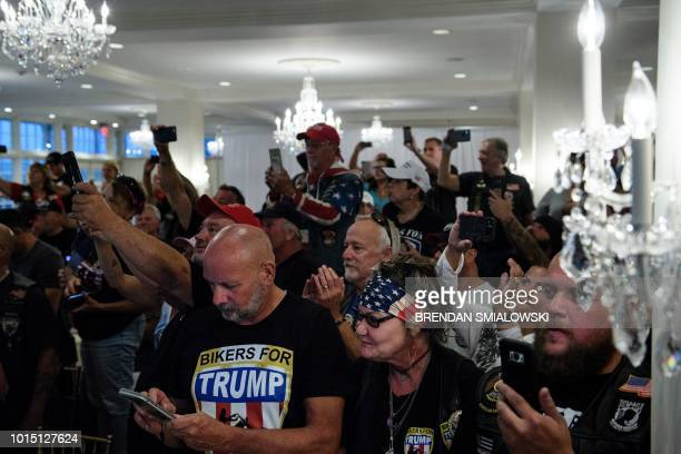 Supporters watch US President Donald Trump during a Bikers for Trump event at the Trump National Golf Club August 11 2018 in Bedminster New Jersey...