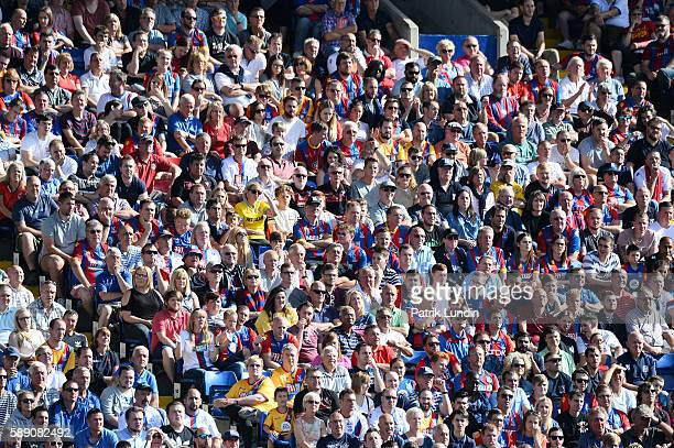 Supporters watches the action during the Premier League match between Crystal Palace FC and West Bromwich Albion FC at Selhurst Park on August 13...