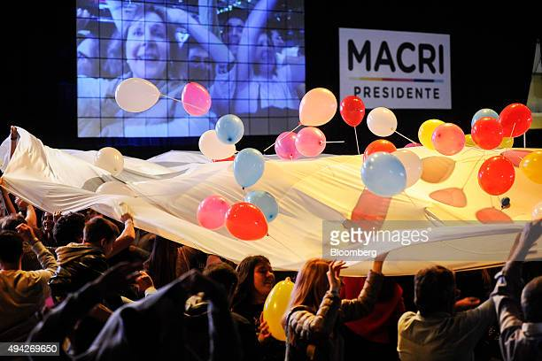 Supporters wave a banner at the campaign headquarters of Mauricio Macri mayor of Buenos Aires and presidential candidate on election night in Buenos...