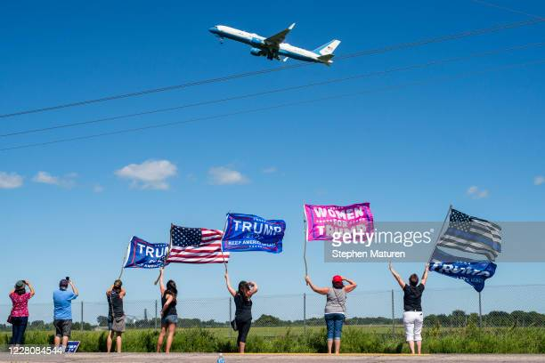 Supporters wave as Air Force One takes off from Mankato Regional Airport with President Donald Trump on board on August 17, 2020 in Mankato,...