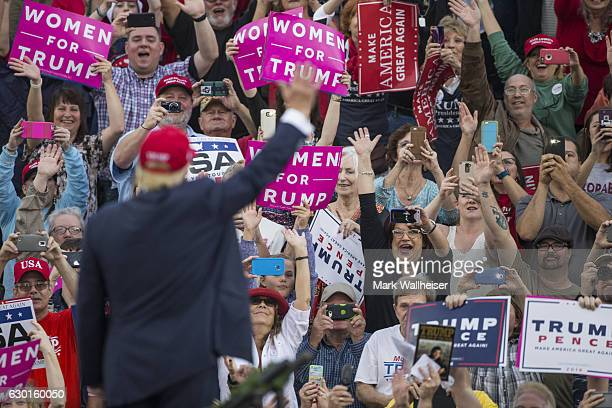 Supporters wave as presidentelect Donald Trump arrives for a thank you rally in LaddPeebles Stadium on December 17 2016 in Mobile Alabama...