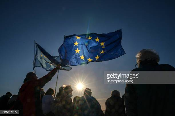 Supporters wave EU flags as they listen to Labour Party Leader Jeremy Corbyn during a rally on Southport Beach on August 18 2017 in Southport England...