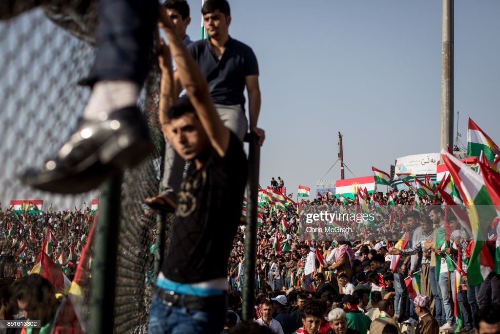 Supporters wave flags and chant slogans inside the Erbil Stadium while waiting to hear Kurdish President Masoud Barzani speak during a rally for the upcoming referendum for independence of Kurdistan on September 22, 2017 in Erbil, Iraq. The Kurdish Regional government is preparing to hold the September 25, independence referendum despite strong objection from neighboring countries and the Iraqi government, which voted Tuesday to reject Kurdistan's referendum and authorized the Prime Minister Haider al-Abadi to take measures against the vote. Despite the mounting pressures Kurdistan President Masoud Barzani continues to campaign and state his determination to go ahead with the vote.