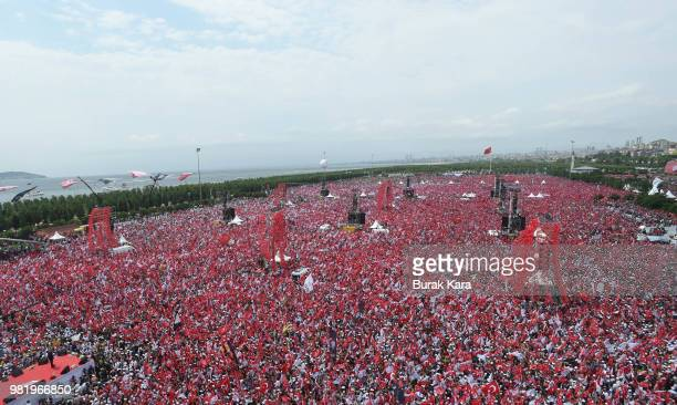 Thousands of supporters wave flags and cheer as they listen during an election rally for Muharrem Ince presidential candidate of Turkey's main...