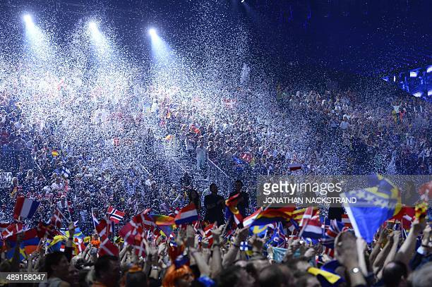 Supporters wave flags as the artists arrive during the Eurovision Song Contest 2014 Grand Final in Copenhagen Denmark on May 10 2014 AFP...