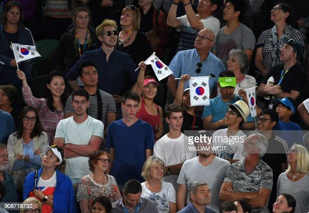 Supporters wave flags as they cheer for South Korea's Hyeon Chung after his victory over Serbia's Novak Djokovic in their men's singles fourth round...