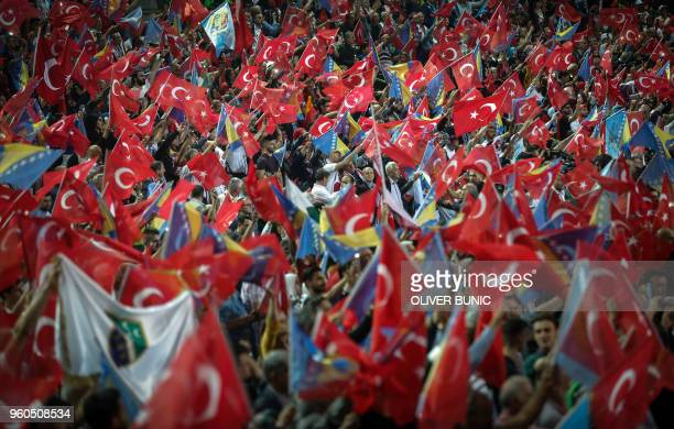 Supporters wave flags as Turkish President speaks during a preelection rally in Sarajevo on May 20 2018 Recep Tayyip Erdogan holds today the only...