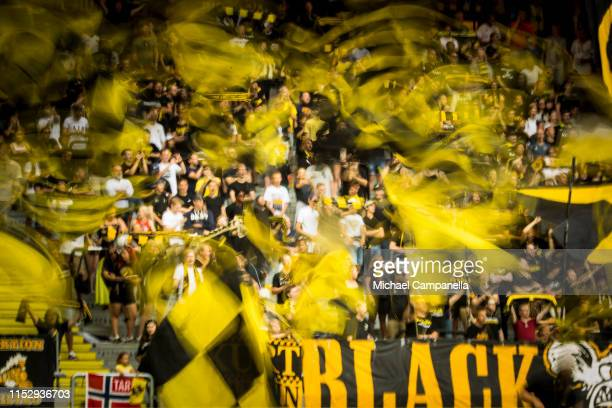 Supporters wave flags during an Allsvenskan match between AIK and Malmö FF at Friends Arena on June 30, 2019 in Stockholm, Sweden.