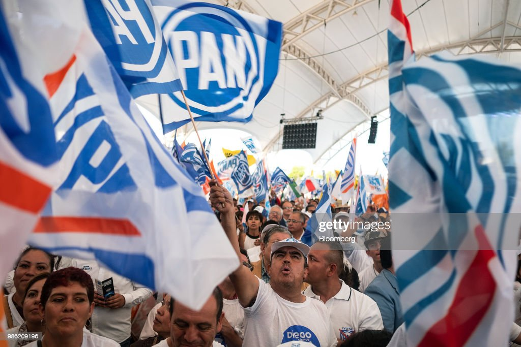 Supporters wave flags during the final campaign rally for Ricardo Anaya, presidential candidate for the National Action Party (PAN), in Guanajuato, Mexico, on Wednesday, June 27, 2018. With just four short days before whats likely to be a historic presidential election in Mexico, were about to enter a blackout period. Its the last day for political advertising, campaign events and publishing new polls. Photographer: Mauricio Palos/Bloomberg via Getty Images