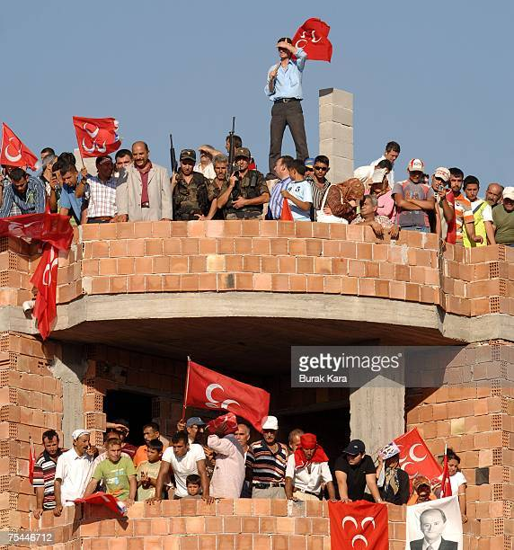 Supporters wave flags for Devlet Bahceli leader of Nationalist Movement Party during a rally July 17 2007 in the southern city of Osmaniye Turkey...