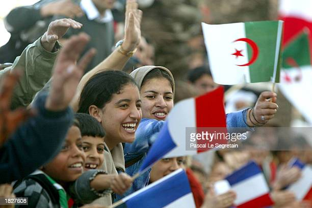 Supporters wave French and Algerian flags for French President Jacques Chirac during an arrival ceremony March 4 2003 in Oran Algeria Chirac the...