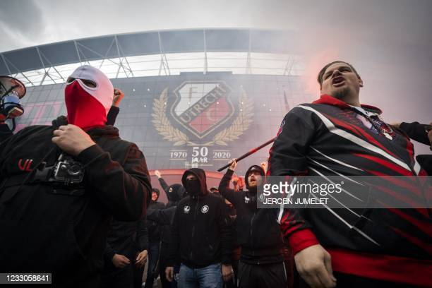 Supporters wave goodbye to the FC Utrecht team outside the Galgenwaard stadium in Utrecht, on May 23, 2021 prior Dutch Eredivisie Europa League...
