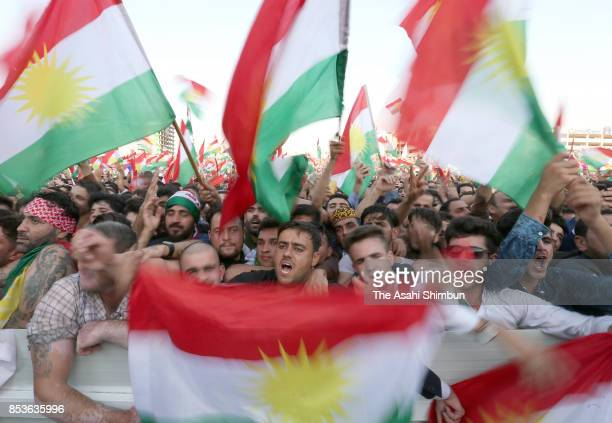 Supporters wave Kurdish flags during a rally for the upcoming referendum for independence of Kurdistan on September 22, 2017 in Erbil, Iraq. The...