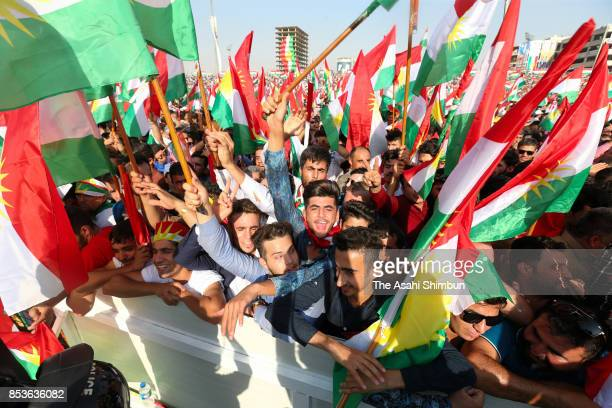 Supporters wave Kurdish flags during a rally for the upcoming referendum for independence of Kurdistan on September 22 2017 in Erbil Iraq The Kurdish...