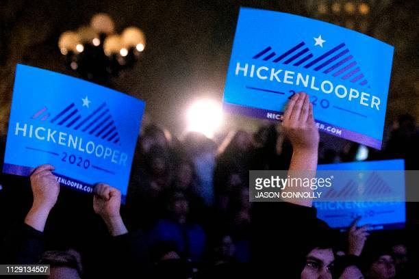 Supporters wave signs during the campaign kickoff rally for 2020 US presidential candidate former Colorado Gov John Hickenlooper at Civic Center Park...