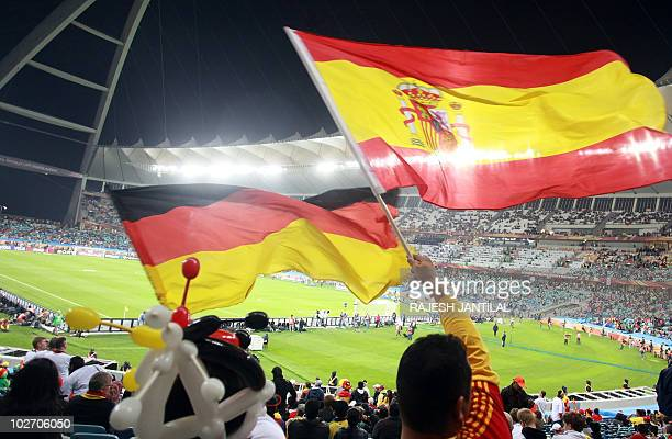 Supporters wave Spanish flags during the 2010 World Cup semi-final football match Germany vs. Spain on July 7, 2010 at Moses Mabhida stadium in...