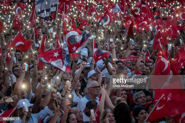 Supporters wave their phones in the air while listening to CHP Party presidential candidate Muharrem Ince during a campaign rally on June 21 2018 in...