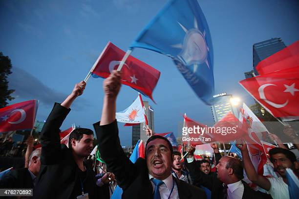 Supporters wave Turkish flags and shout slogans outside the AK Party headquarters in Ankara Turkey June 7 2015 Partial results from Turkey's...