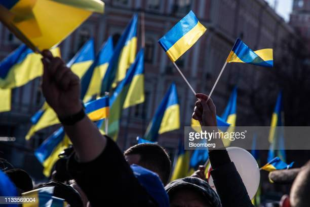 Supporters wave Ukrainian flags at a political rally for Yulia Tymoshenko former Prime Minister not pictured in Kiev Ukraine on Friday March 29 2019...
